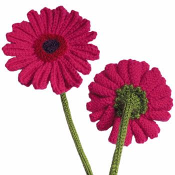 These are wonderful! It's a free knit pattern for gerbera daisies. I'm thinking of making a batch for Mother's day this year.