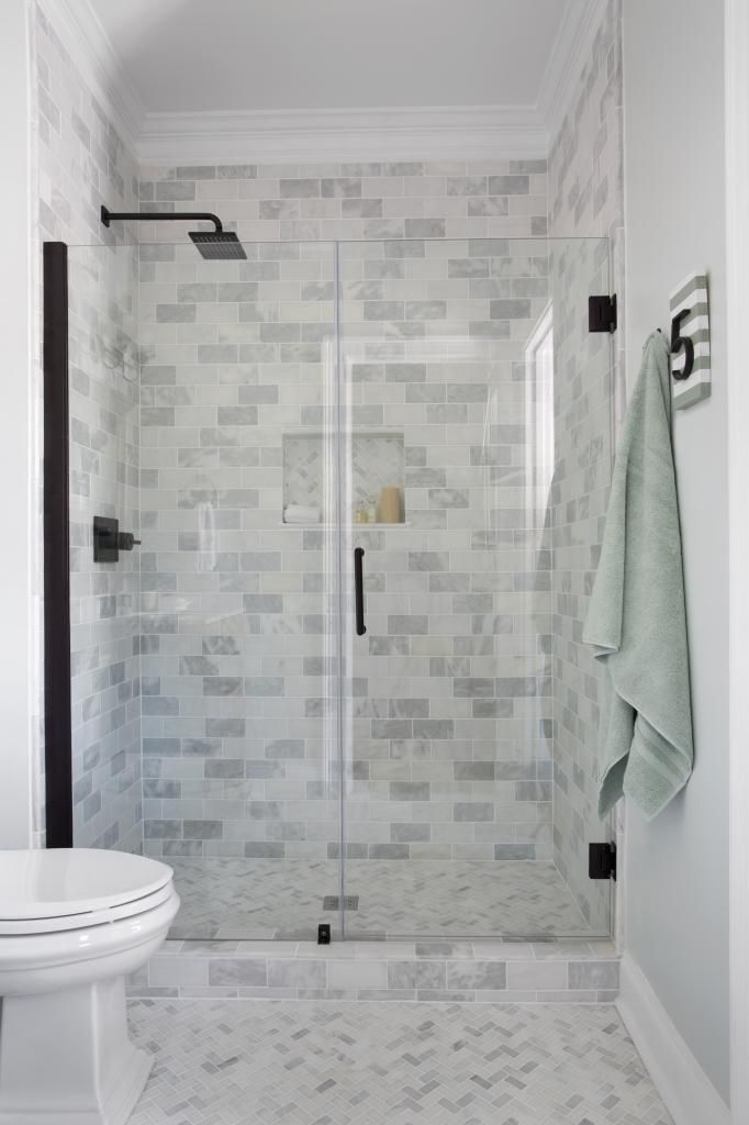 Bathroom using Cream Herringbone bathroom floor tile. https://www.pebbletileshop.com/products/Cream-Herringbone-Stone-Mosaic-Tile.html#.VVzyjflViko