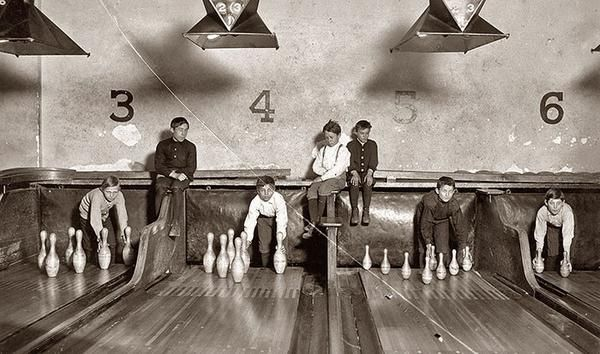 Before automatic pinsetters were invented, pin boys worked to manually line them up. (1914). #automatic #pinsetters #bowling #sport