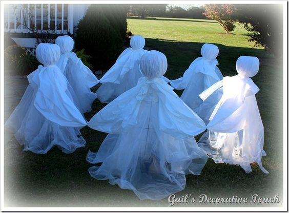 I made six of them using a tomato cage, a pumpkin, plastic drop cloth and a round plastic table cover for each one.