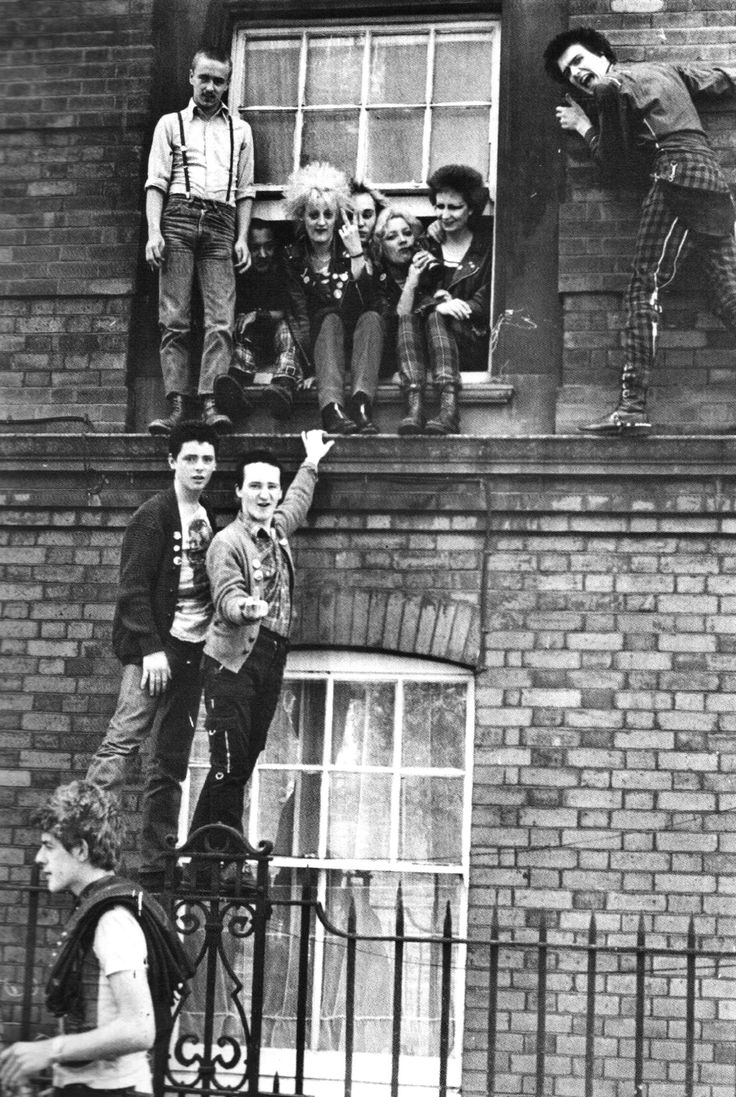 A group of punks and skinheads face eviction from a house in which they had been squatting, UK. June 25. 1979. °
