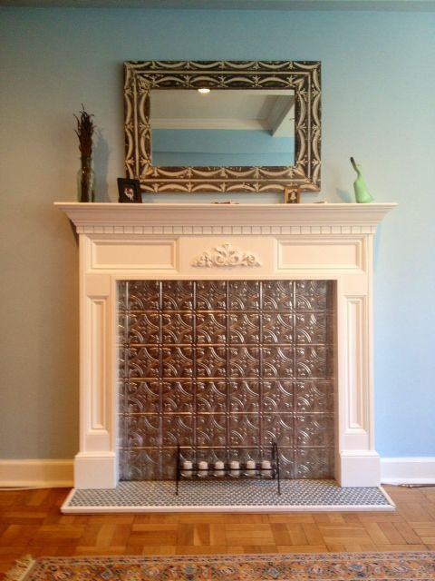My finished faux fireplace with tin tile. // Faux fireplace ideas. - 17 Best Ideas About Faux Fireplace On Pinterest Fake Fireplace