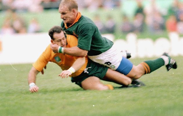 Francois Pienaar of South Africa tackles David Campese of Australia during the opening Rugby World Cup match at Newlands on May 25, 1995 in Cape Town.