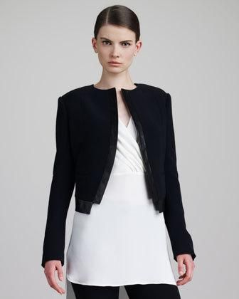 Crepe with leather trim. Round neckline. Open front. Sharp shoulders. Long sleeves. Cropped high on hip. Acetate/viscose/wool/nylon. Dry clean. Made in Italy