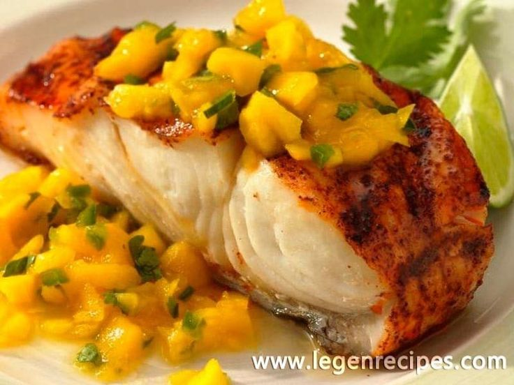 Grilled Halibut with Mango Sauce. Tropical fruit and spices pack a flavorful punch over healthful grilled fish.