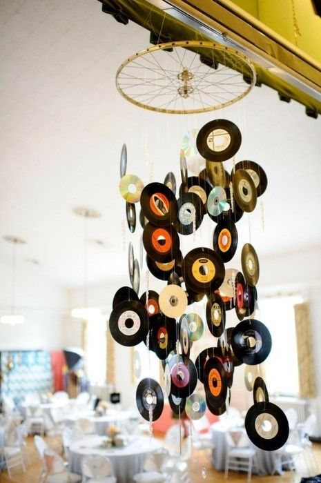 These creative music mobiles would be a great decorative piece for a music fan's room or as a centerpiece for a party.  For a party, you could attach real records or you could create records out of construction paper and add labels of the birthday boy/girl's favorite songs or a song from each decade.  In addition, you can use your song choices as your playlist for the party.  Notice that they added cd's into this mobile as well.