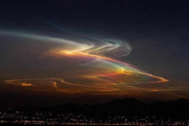 Sonora Borealis  This highly unusual cloud formation was likely formed from the exhaust of a rocket launched from Vandenberg Air Force Base in Southern California roughly an hour before this capture. The photo was taken from a mountain ridge near Tucson, AZ.    Best viewed large on black