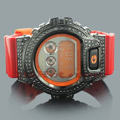 This Red G-Shock Watch with Black Crystals is based on the original DW6900 model. This trendy watch features sparkling black crystals around the bezel, a black tone stainless steel case, a red glossy rubber watch band and an orange digital dial code. Water-resistant to 200m. This G-Shock Watch is a stylish addition to any wrist.