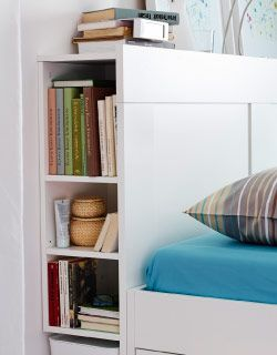I love the idea of having a little book shelf in my headboard