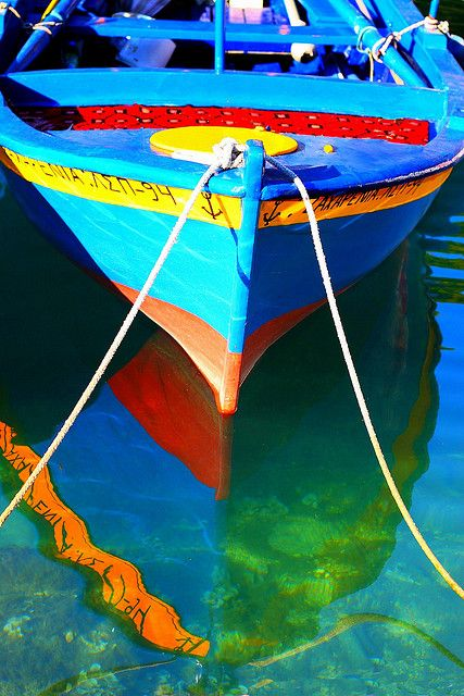 Fishing boat reflected in the sea by Marite2007, via Flickr