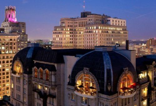 This historic hotel in Philadelphia has arched openings, groin vaults, balconies, stone facade, and classical aesthetic.