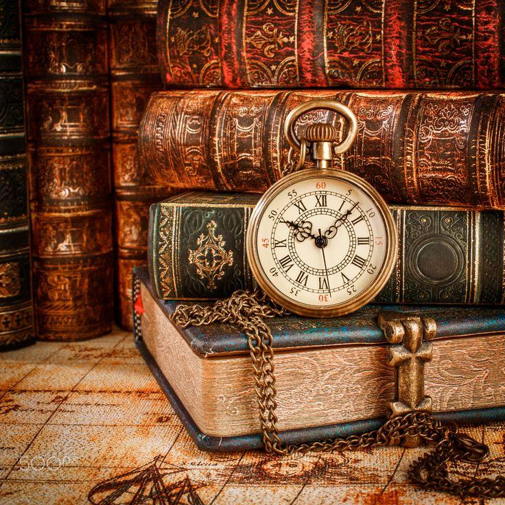 Old Books and Vintage pocket watch - Vintage Antique pocket watch on the background of old books