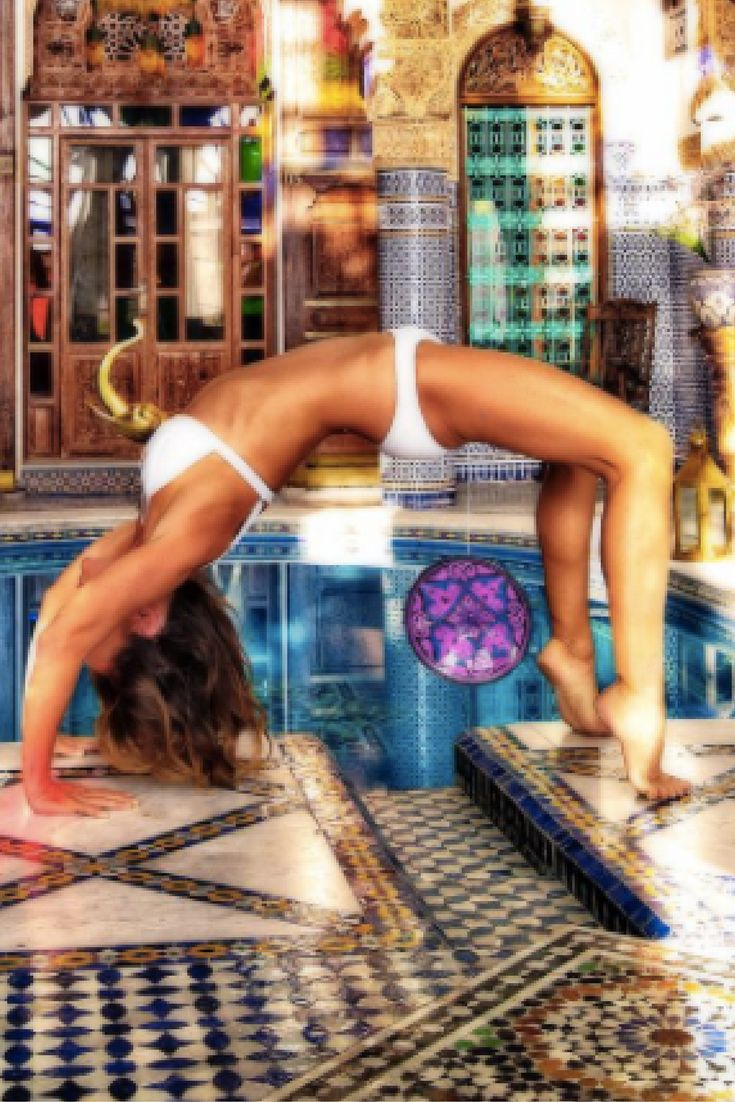 THE MOROCCO SERIES | Backbend in magical, mosaic courtyard, with ceramic plate.  Check out how perfectly the tiled pillars reflect in the pool.  Morocco is an explosion of color and art. Everywhere.  Beautiful country.