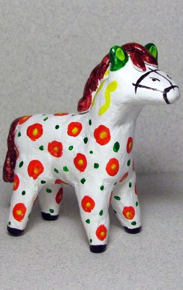 Dymkovo toy is a painted clay toy from the Russian village of Dymkovo. A horse…