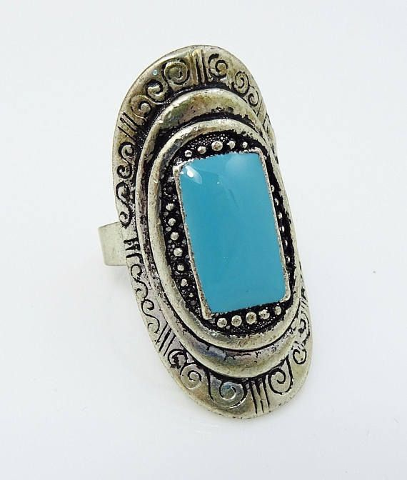 Big massive ring that will definitely make a statement! Cool southwestern inspired design with turquoise enamel. #adoredblessings #vintagejewelry