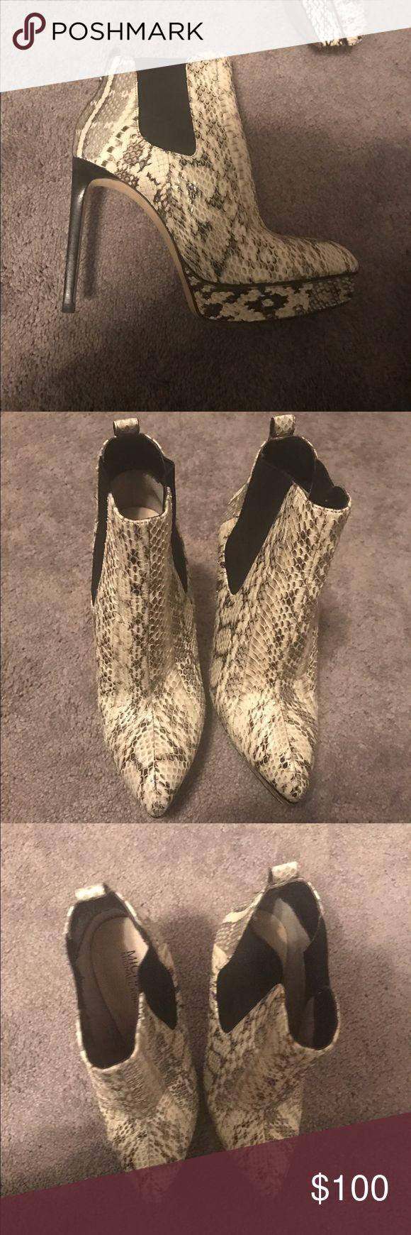 Michael Kors white and black snake skin booties MIchael Kors black and white sneak skin booties. Michael Kors Shoes Ankle Boots & Booties