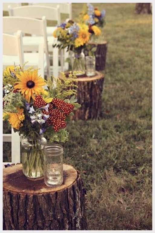 rustic outdoor wedding aisle ideas-sunflowers and wildflowers in mason jars