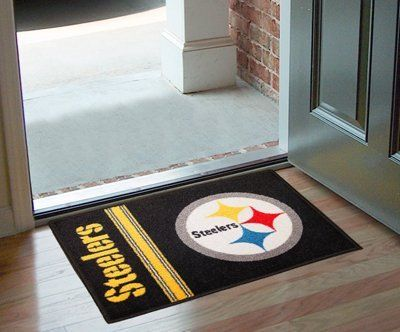 "Pittsburgh Steelers Starter Rug 20""x30"" by Fanmats. $13.68. Pittsburgh Steelers Starter Rug 20""x30""Decorate your home or office with area rugs by FANMATS. Made in U.S.A. 100% nylon carpet and non-skid recycled vinyl backing. Officially licensed and chromojet printed in true team colors. Please note: These products are custom made. The normal lead time is about 7-10 business days. However, the putting mats and carpet tiles do take a little longer, about 14-21 bus..."