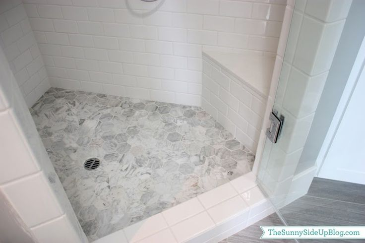 Master Bathroom Features Corner Shower Accented With