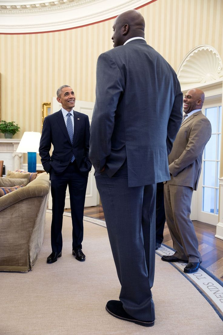 Feb. 27, 2015: It's definitely true that former NBA player Shaquille O'Neal is a big guy. But I'll admit that I used a wide angle lens and this angle to accentuate his size when he stopped by the Oval Office for a quick visit.