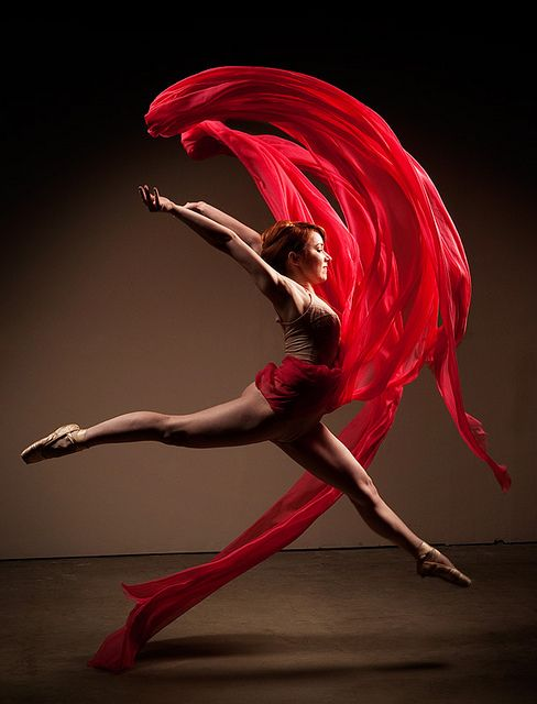 Ballet leap in red.