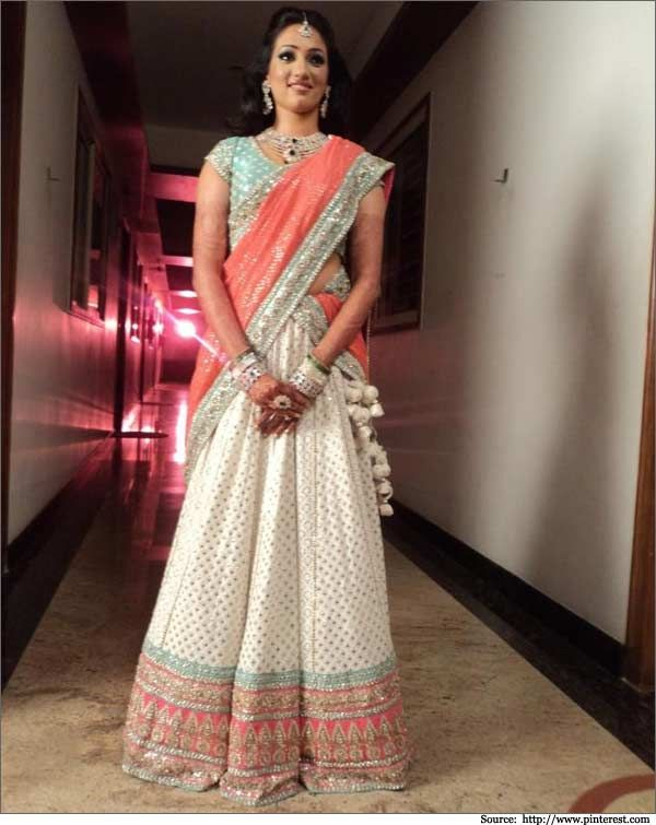 white tarana #embroidery work across the lehenga.   #bandbaajabride #bridaloutfits