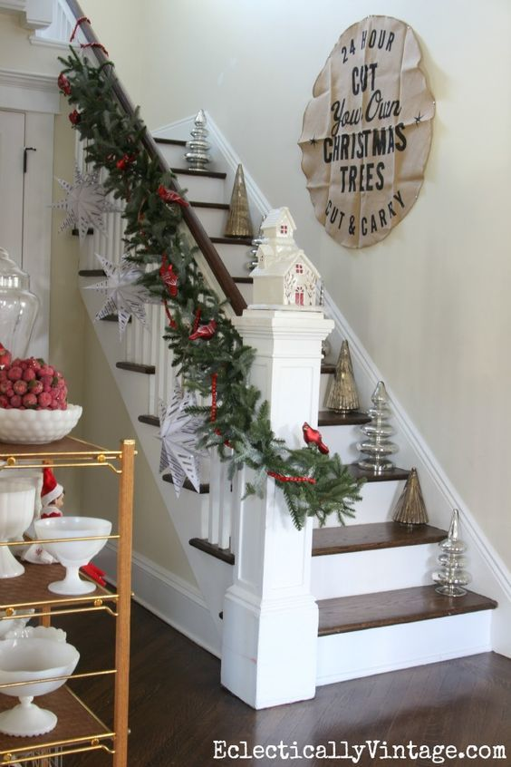 Love this banister with garland, huge paper snowflakes and mercury glass trees o… – M.L.H.