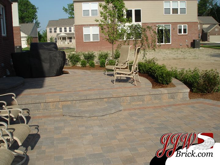 Wonderful Brick Patio Design With Built In Flower Box And Surrounding Landscapes In  Macomb Twp.,