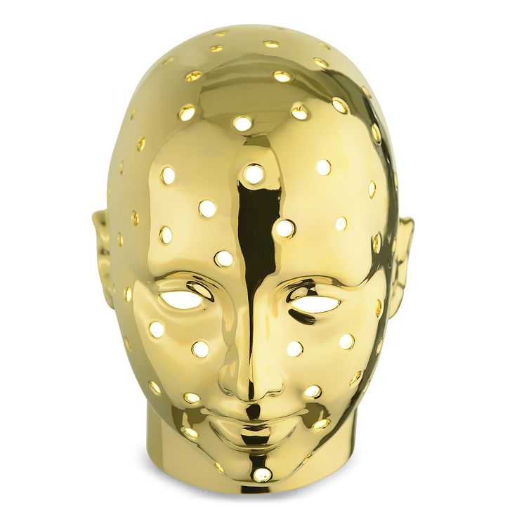 Ceramic holed man's head designed by Simone Micheli for Marioni. Lighted by stip led. www.marioni.it