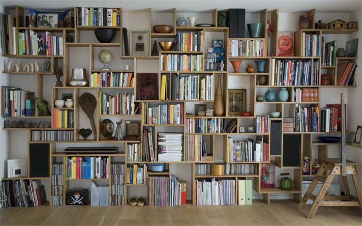 I enjoy seeing spaces that take pride in the books contained there in.  Don't try to hide your books.
