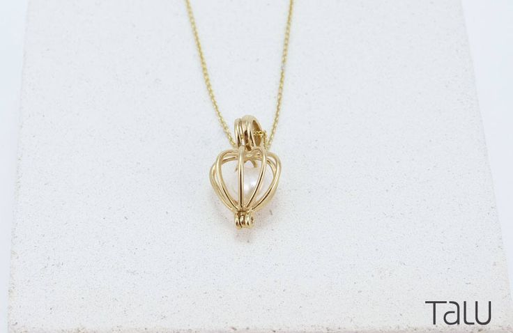 A personal favourite from my Etsy shop https://www.etsy.com/listing/519064284/gold-pearl-necklace-small-cage-design