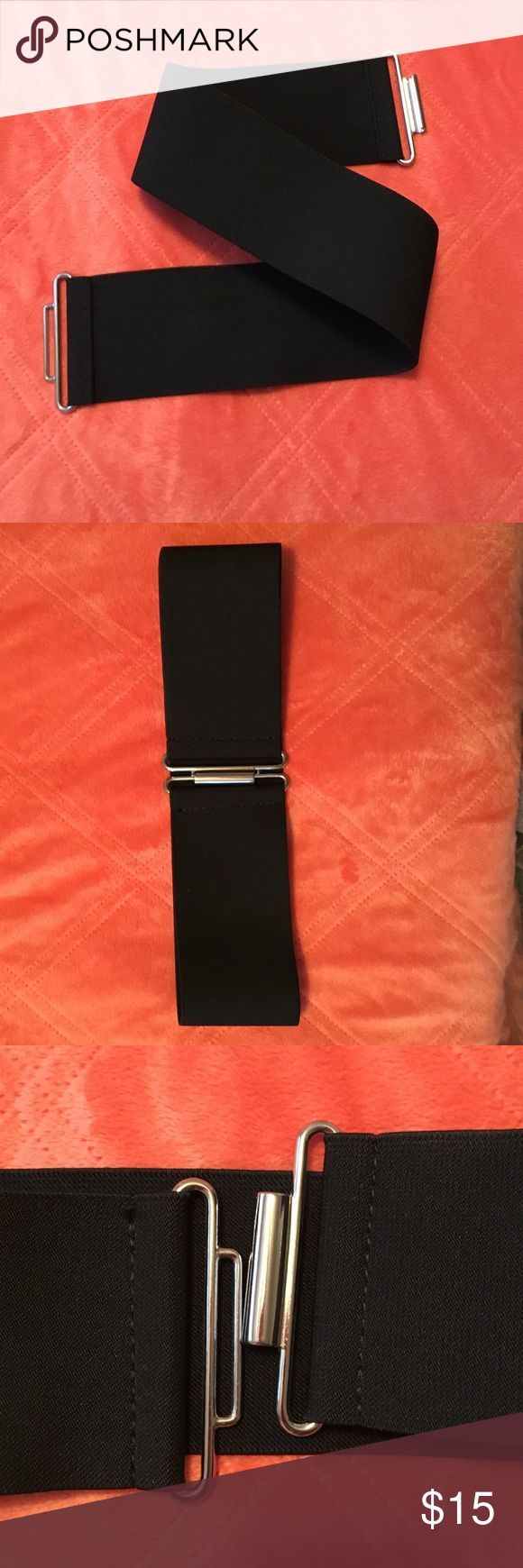 """Wide, black stretch belt Wide, black stretch belt from express. Like new. Great accessory. 24.5"""" with a good amount of stretch. Express Accessories Belts"""