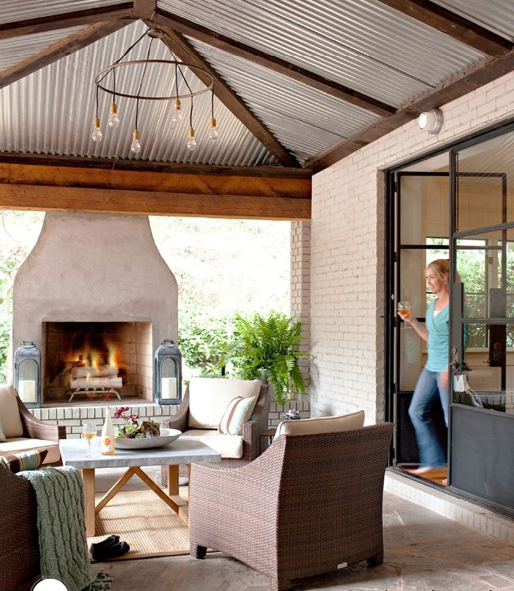 Making the outdoor feel in ... Love the tin roof!  #Patio #Outdoor living