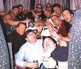"Gerald Briscoe (bottom left) Triple H, Henry Godwin, Kevin Nash, The Undertaker, Mideon, ""Stone Cold"" Steve Austin, Scott Hall, Shawn Michaels, Sean Waltman (X-Pac), and Paul Bearer."