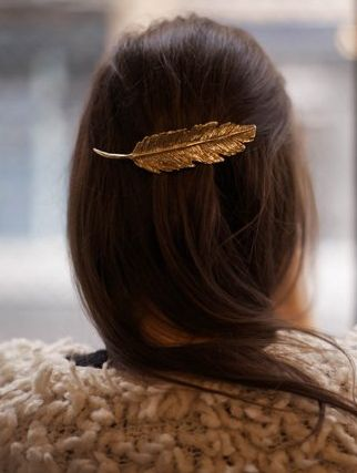 gold feather hair accessory