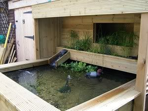 Very cool raised pond with bog filter looks like a for Raised koi pond ideas