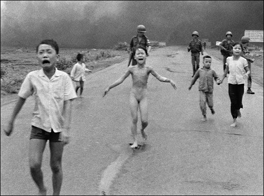 9-year-old Kim Phuc (center) as they run down a road near Trang Bang after an aerial napalm attack on suspected Viet Cong hiding places. June 8 1972.