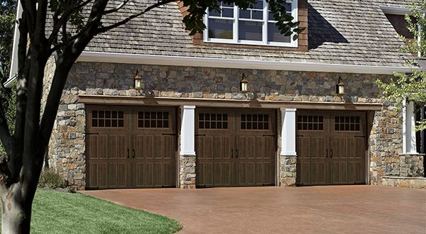 Looks can be deceiving with these Classica® Garage Doors, available through Hamilton Parker. From a distance they look like wood, but up close they're low maintenance steel. #housetrends http://hamiltonparker.com