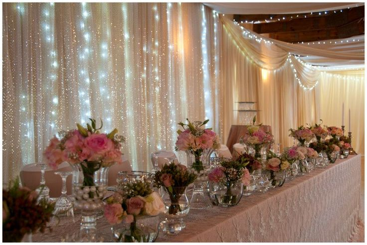 Stunning pink bridal table with fairy lights and draping