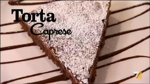Deliziosa torta al cioccolato e mandorle, croccante all'esterno e soffice all'interno. E' una ricetta facile e veloce e non contiene farina