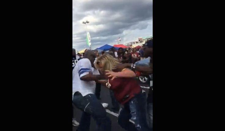 Guy In Cowboys Jersey Attacks Female Redskins Fan In Parking Lot Brawl