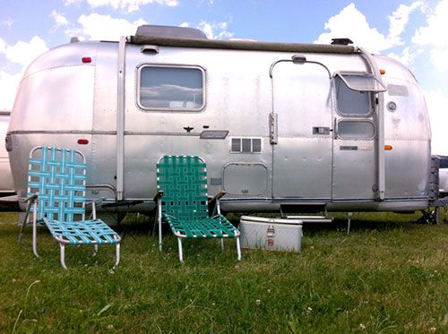 """Sneak Peek: Amelia the Airstream. """"The vintage cooler was my Grandpa Fournier's, which he used when ice fishing in his hometown of Brewer, Maine. The vintage loungers were both found at area yard sales; perfect for morning coffee and one of those good old books."""" #sneakpeek"""