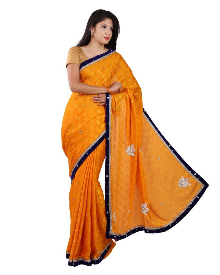 Attractive in design this marigold orange color stone work saree with blue velvet border which is suitable for any occasion.Measuring about 5.5m in length,it