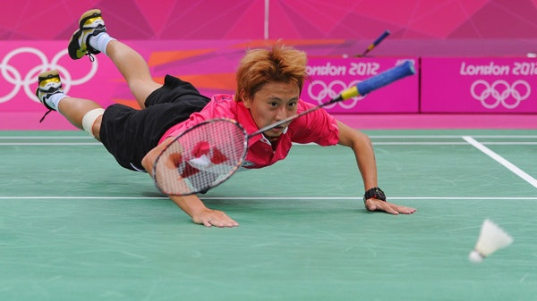 Shao Chieh Cheng of Chinese Taipei dives and loses her racket against Juan Gu of Singapore in their Women's Singles Badminton on Day 5 of the London 2012 Olympic Games at Wembley Arena at Wembley Arena on August 1.