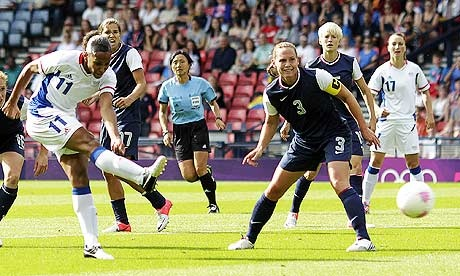 France's Marie-Laure Delie scores their second goal as France takes the early lead against the USA.