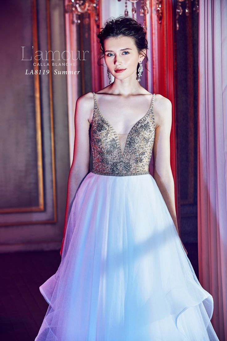 LA8119 Summer  Spaghetti Strap ball gown with crystal beaded bodice.  Made for the modern day princess.  #lamourbycallablanche #lamour #callablanche #callabride #spaghettistrap #swarovski #crystal #ballgown #tulleskirt #sheerbodice #modernbride #princess #deepplunge #plunging #neckline