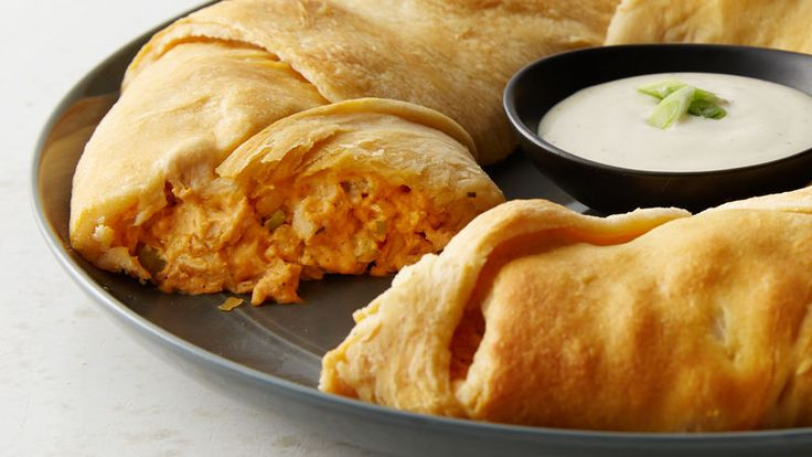 Like Buffalo chicken? Then you're gonna love, love, lurrrve this party-ready recipe! Buttery crescents are baked around a savory, spicy, creamy filling no one can resist. (Tastes great with a side of ranch for dipping, natch.)