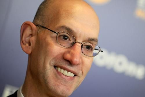 NBA boss Adam Silver was waving a rainbow flag and dancing this weekend at a gay pride parade in New York City.