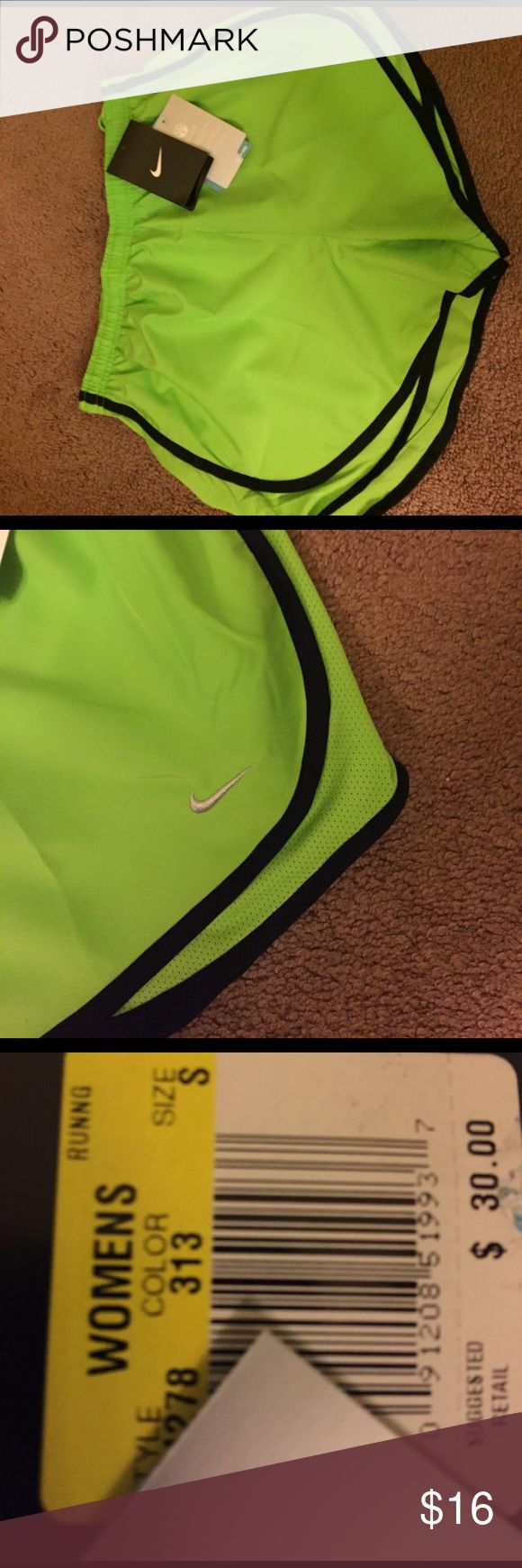 Nike dry fit running shorts Neon green with black lining new With tags silver Nike symbol left lower corner and breathable sides dry fit material Nike Shorts