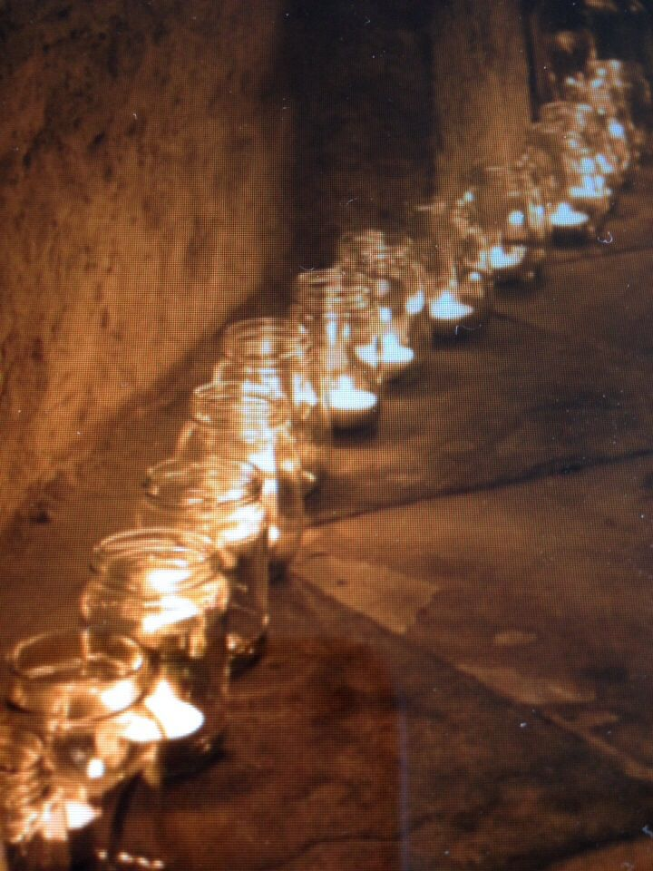 save up your old pasta sauces and jam jars and buy a heap of tea lights - cheap as....